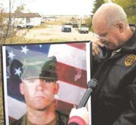 Associated Press Donn Edmunds, father of Army Ranger Spc. John Edmunds holds back tears as he talks about his son Monday.
